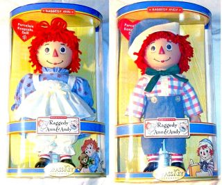 Dolls Raggedy Ann and Raggedy Andy Porcelain Brass Key