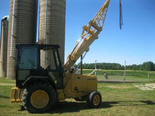 Ford 555C Tractor with Equipment Lifting Boom