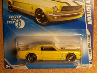 HW Ford Mustang Fastback in yellow w/ black tampo & FTE wheels 132/240